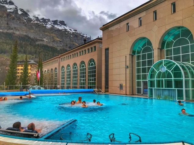 indoor and outdoor thermal pools with mountain views